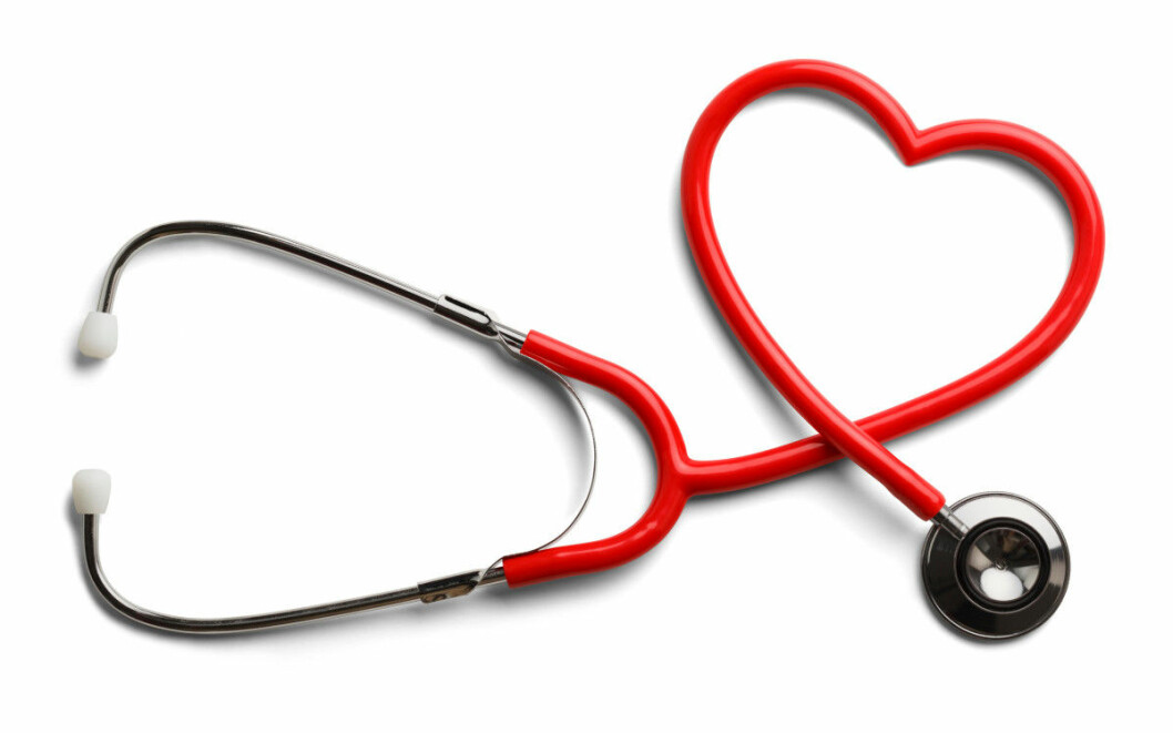 Red Stethoscope in Shape of Heart Isolated On White Background.