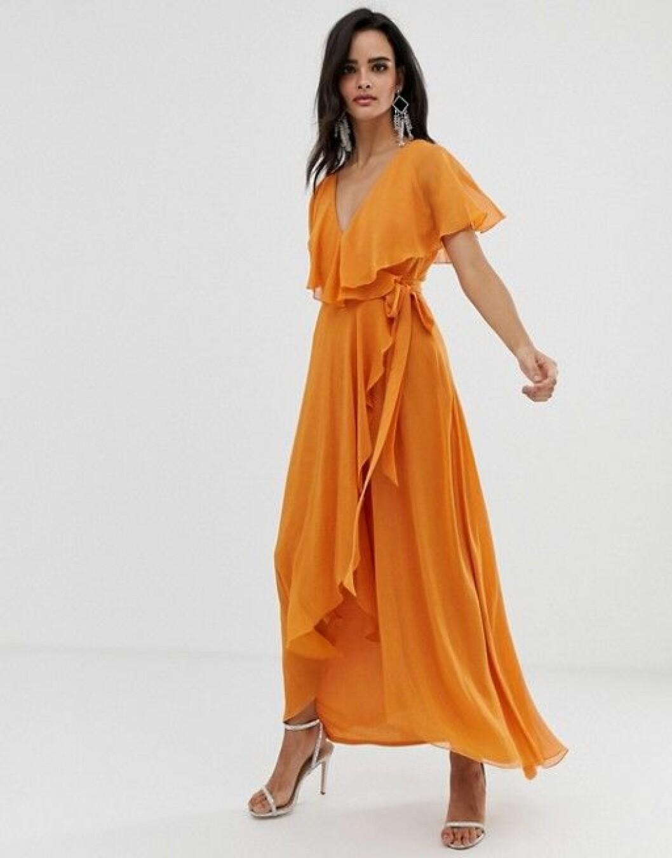 en bild på en orange maxiklänning med knytband från Asos Design.