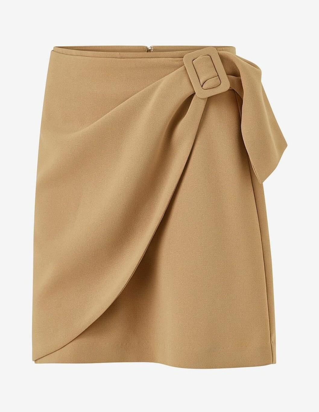 Beige kjol med spänne på ena sidan för dam till våren 2020