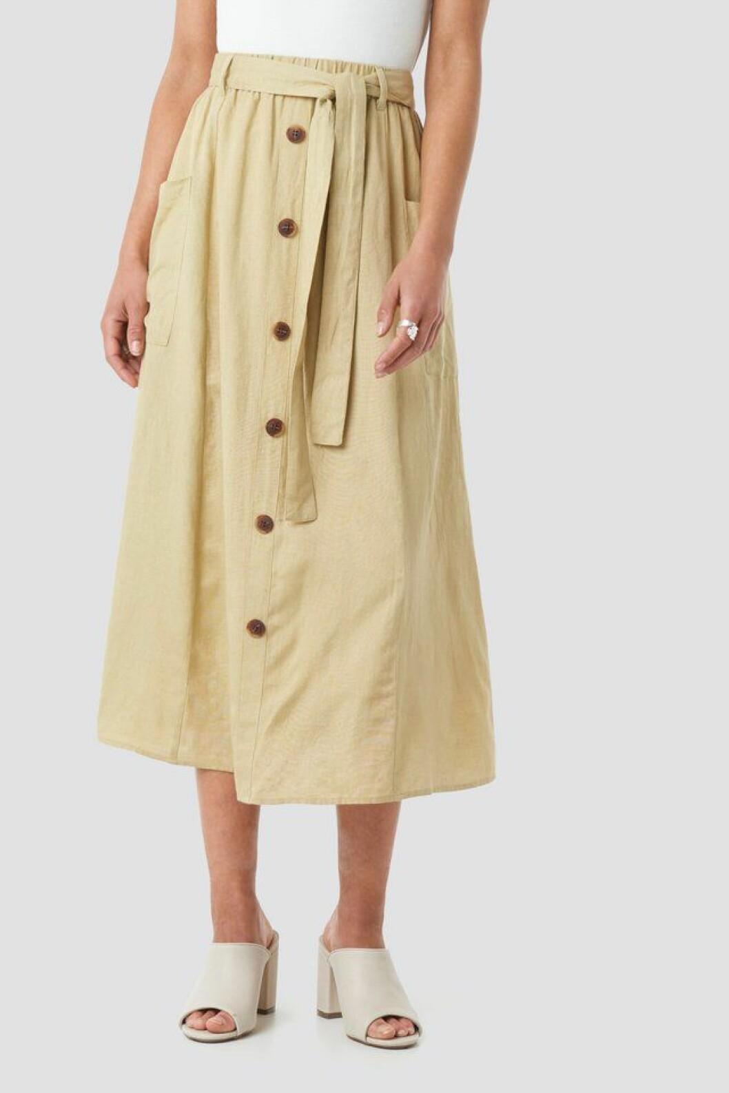 Beige kjol med knappar framtill för dam till 2020