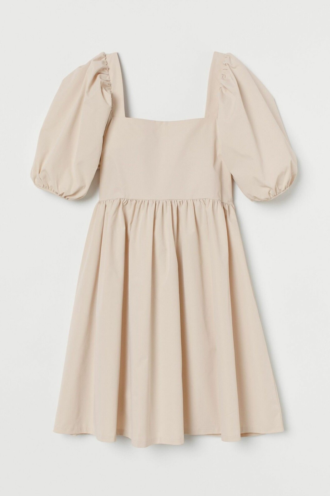 Beige klänning med öppen rygg och knytdetalj