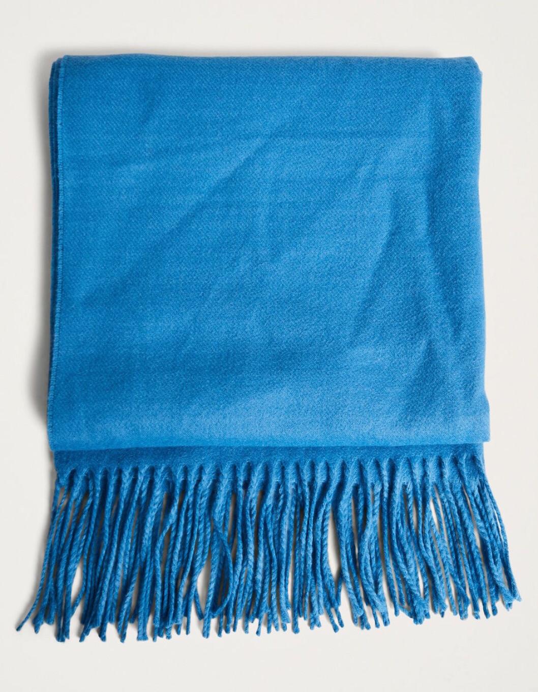 Blå stickad halsduk