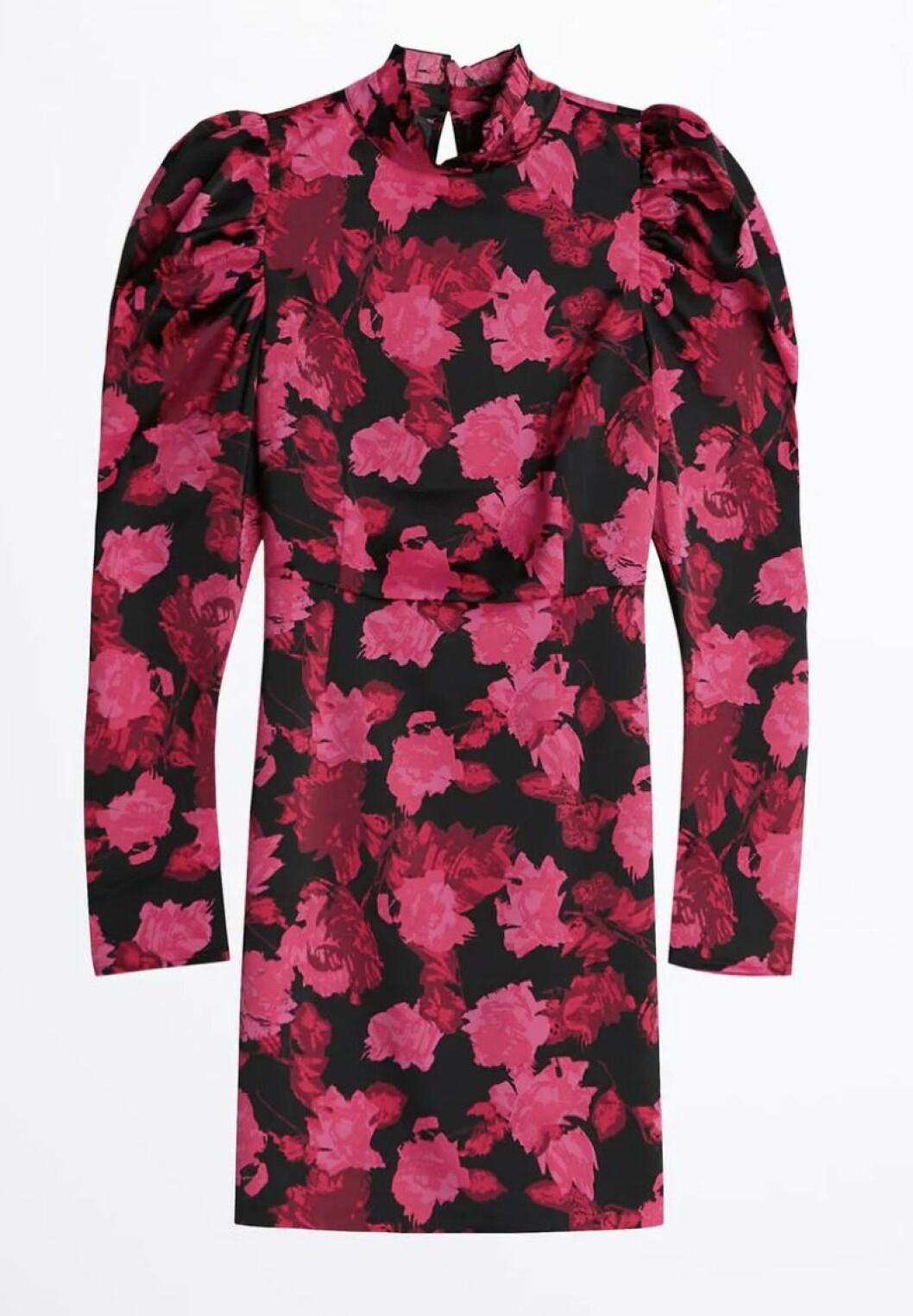 Blommig festklänning med puffärm för dam till 2019
