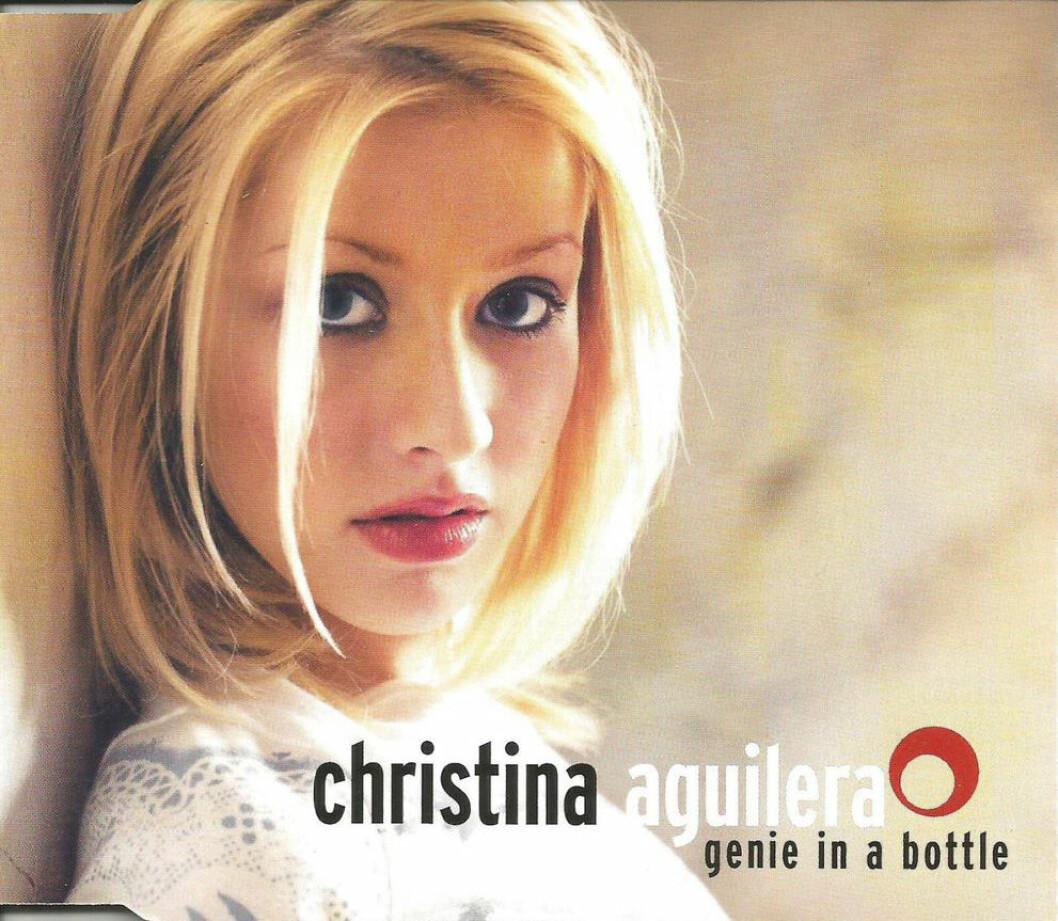 Omslag till singeln Genie in a bottle av Christina Aguilera.