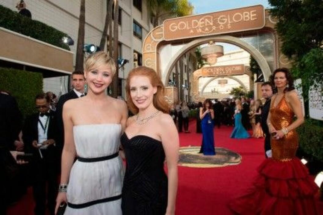 Jennifer Lawrence och Jessica Chastain på Golden Globe Awards 2014.