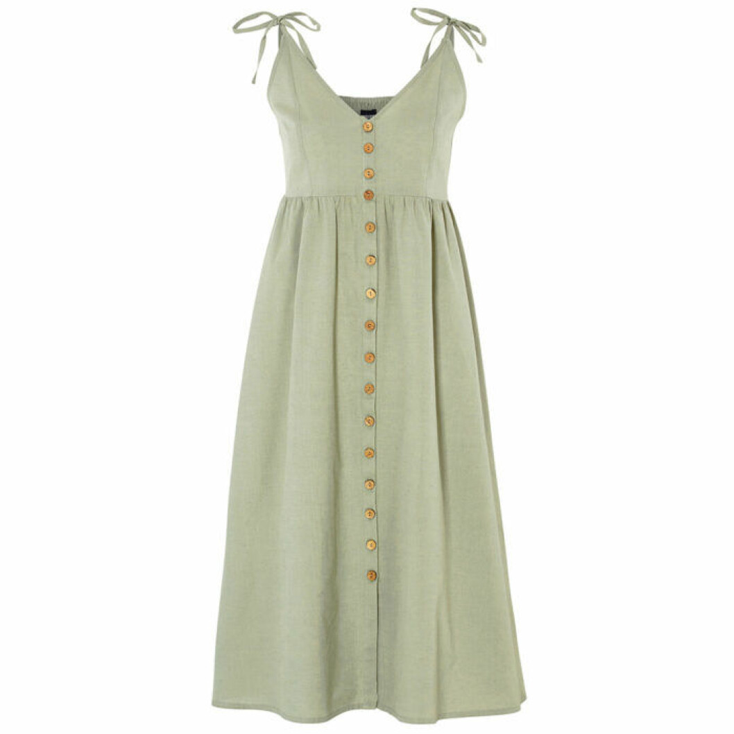 Grön klänning med knappar