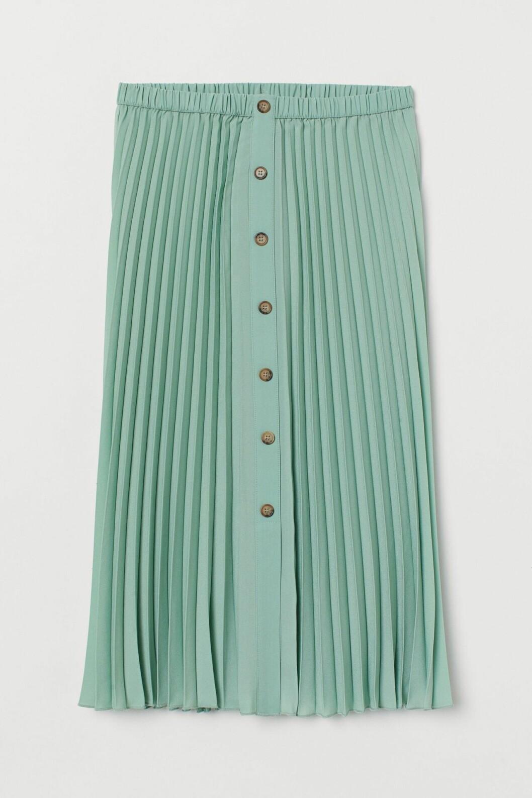 Grön plisserad kjol med knappar för dam till 2020