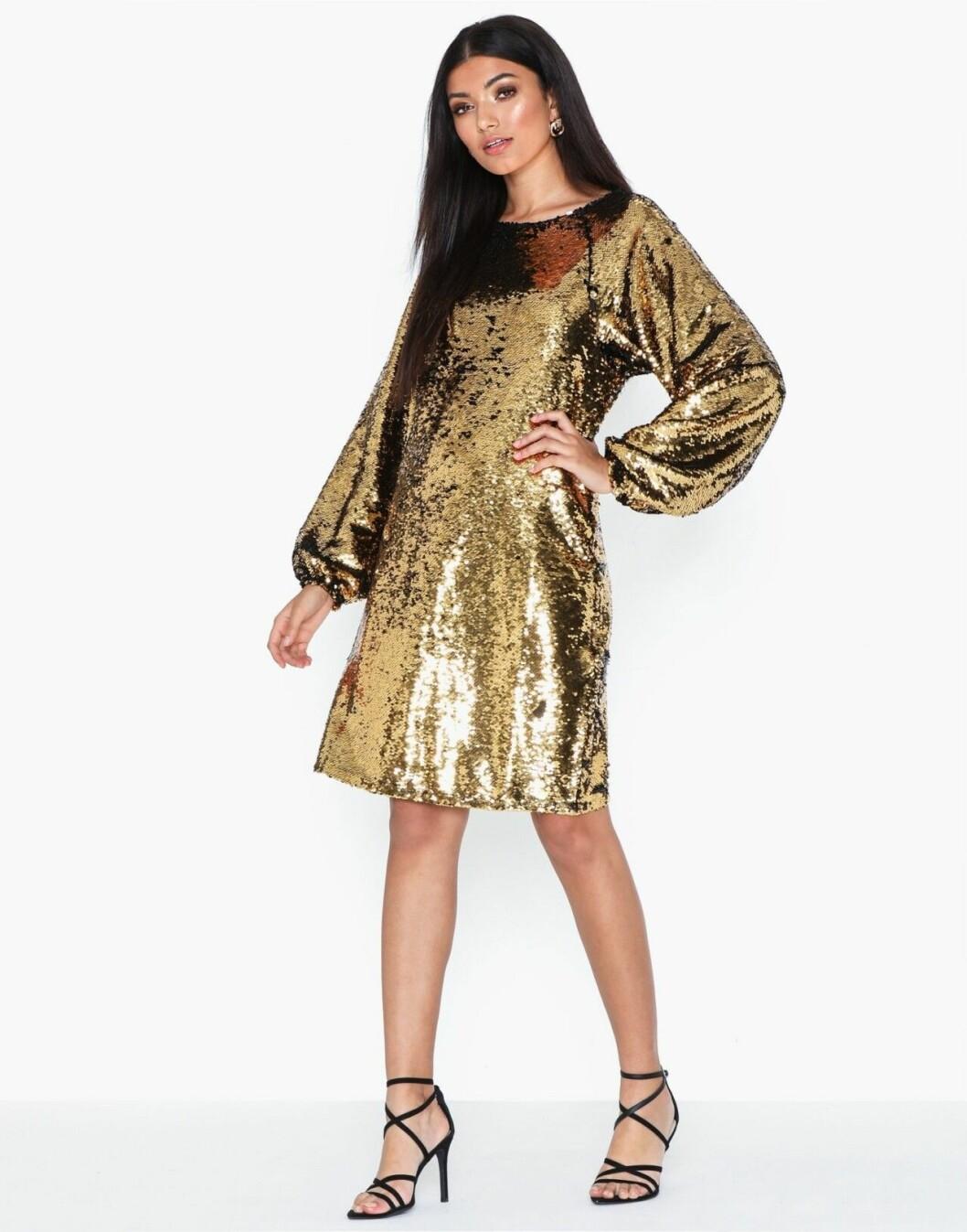 Guldfärgad paljettklänning för dam till nyårsfesten 2019