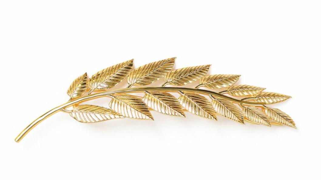 Håraccessoar med guldfärgade blad