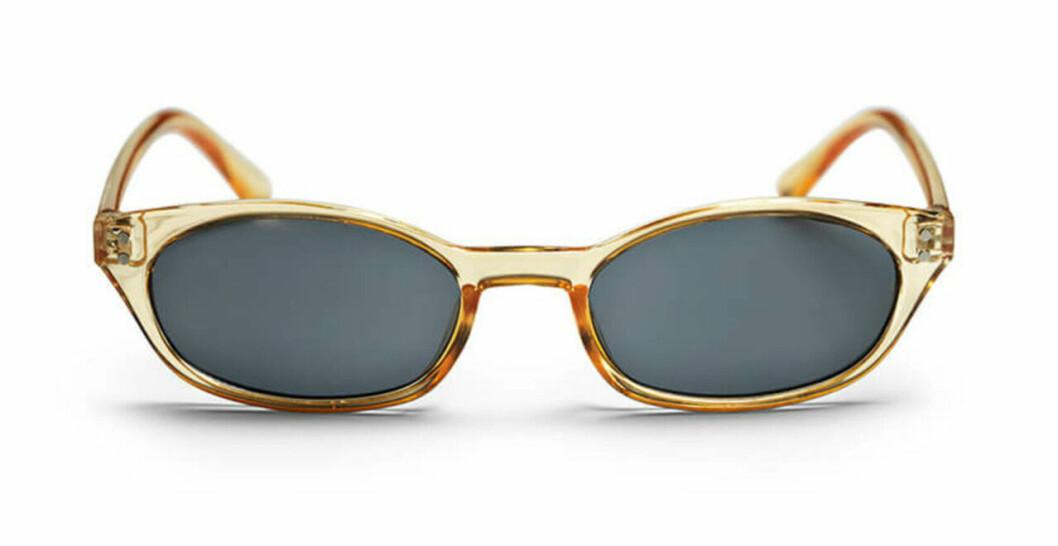 Honungsfärgade solglasögon med ovala bågar