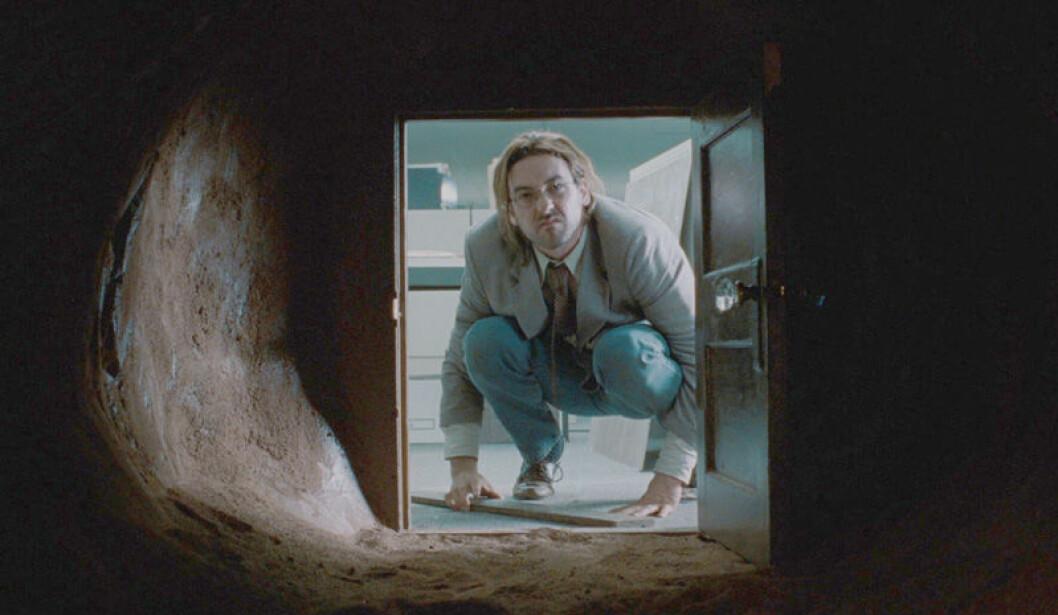 John Cusack går in i John Malkovich's huvud.