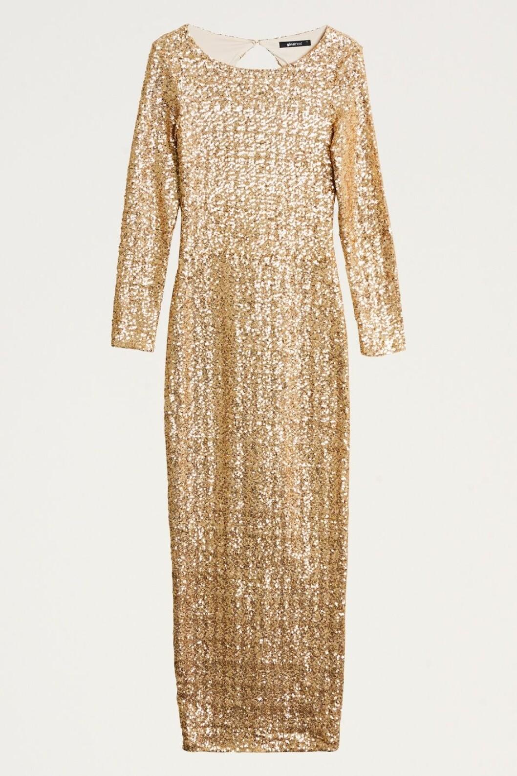 Guldig paljettklänning till fest