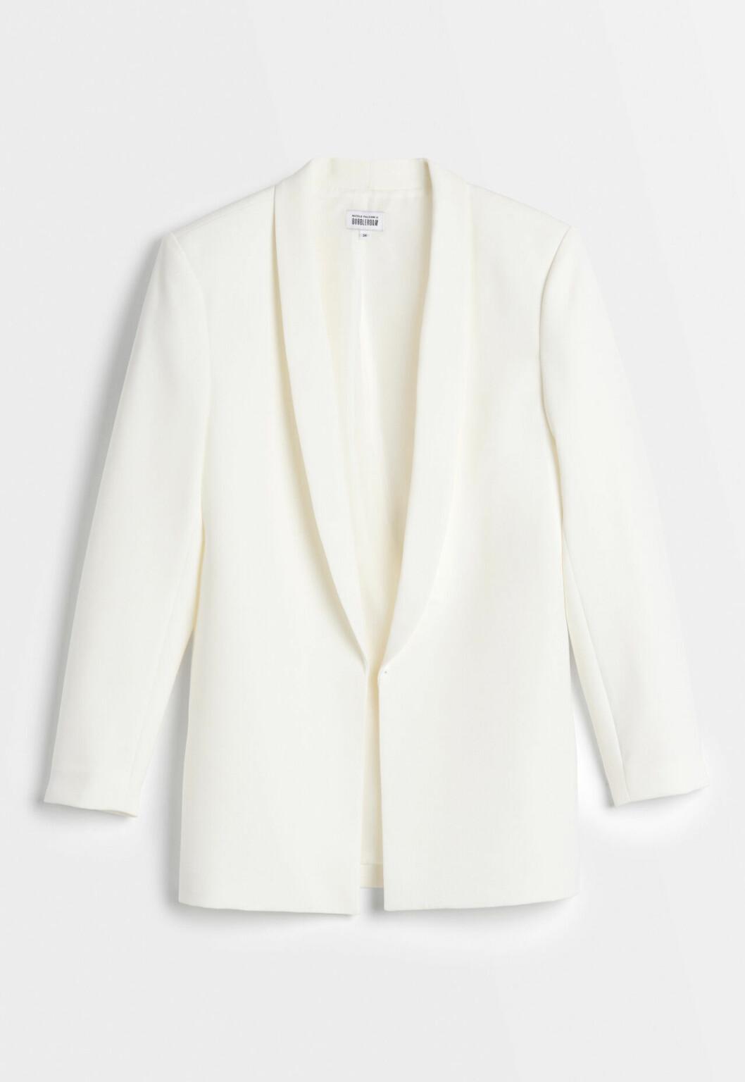 Vit kostym från Nicole Falcianis bröllopskollektion för Bubbleroom