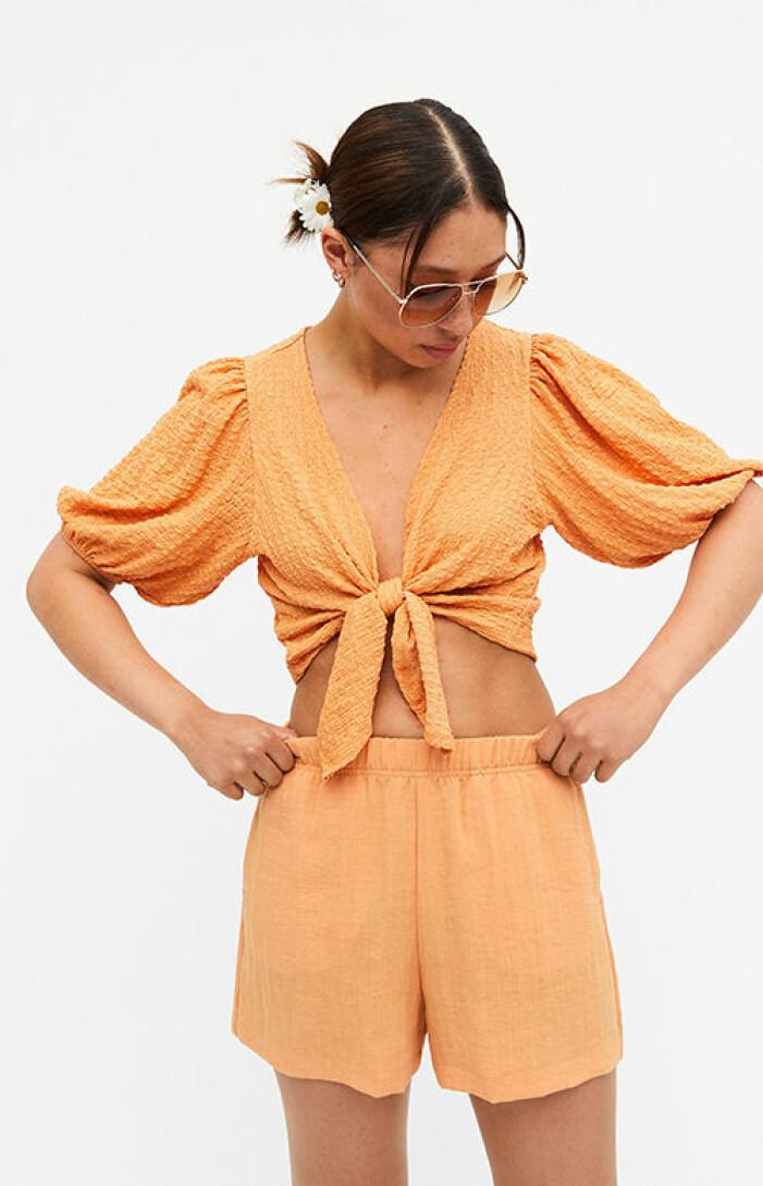orange matchande set med topp och shorts