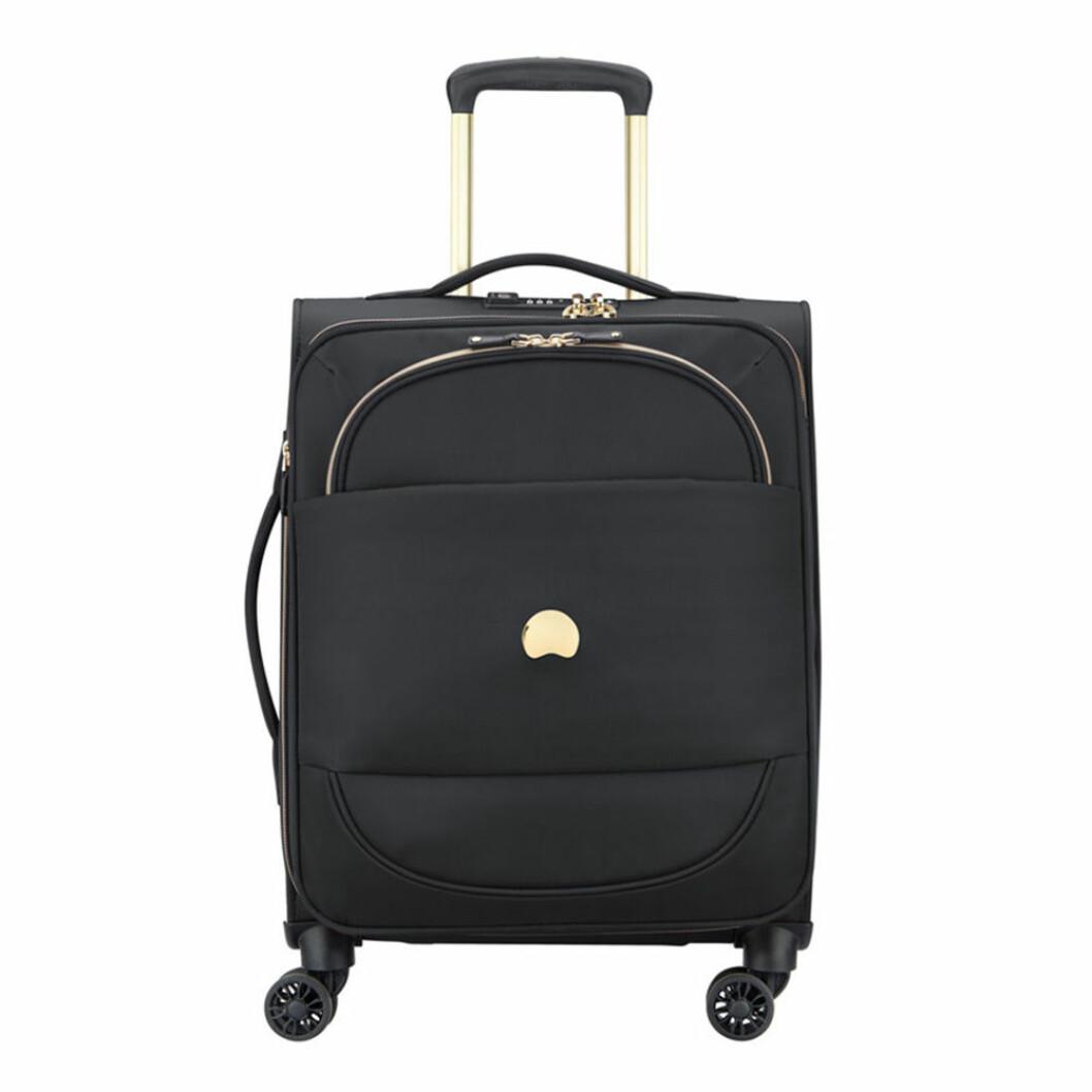 Svart resväska med gulddetaljer