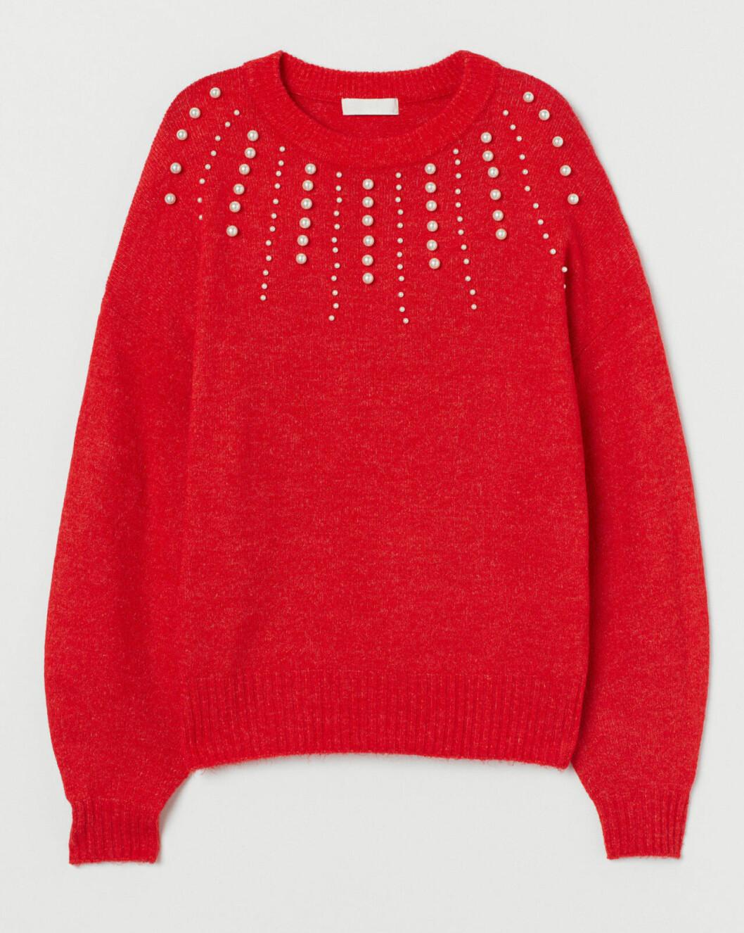 Röd stickad tröja till julfesten och julbordet