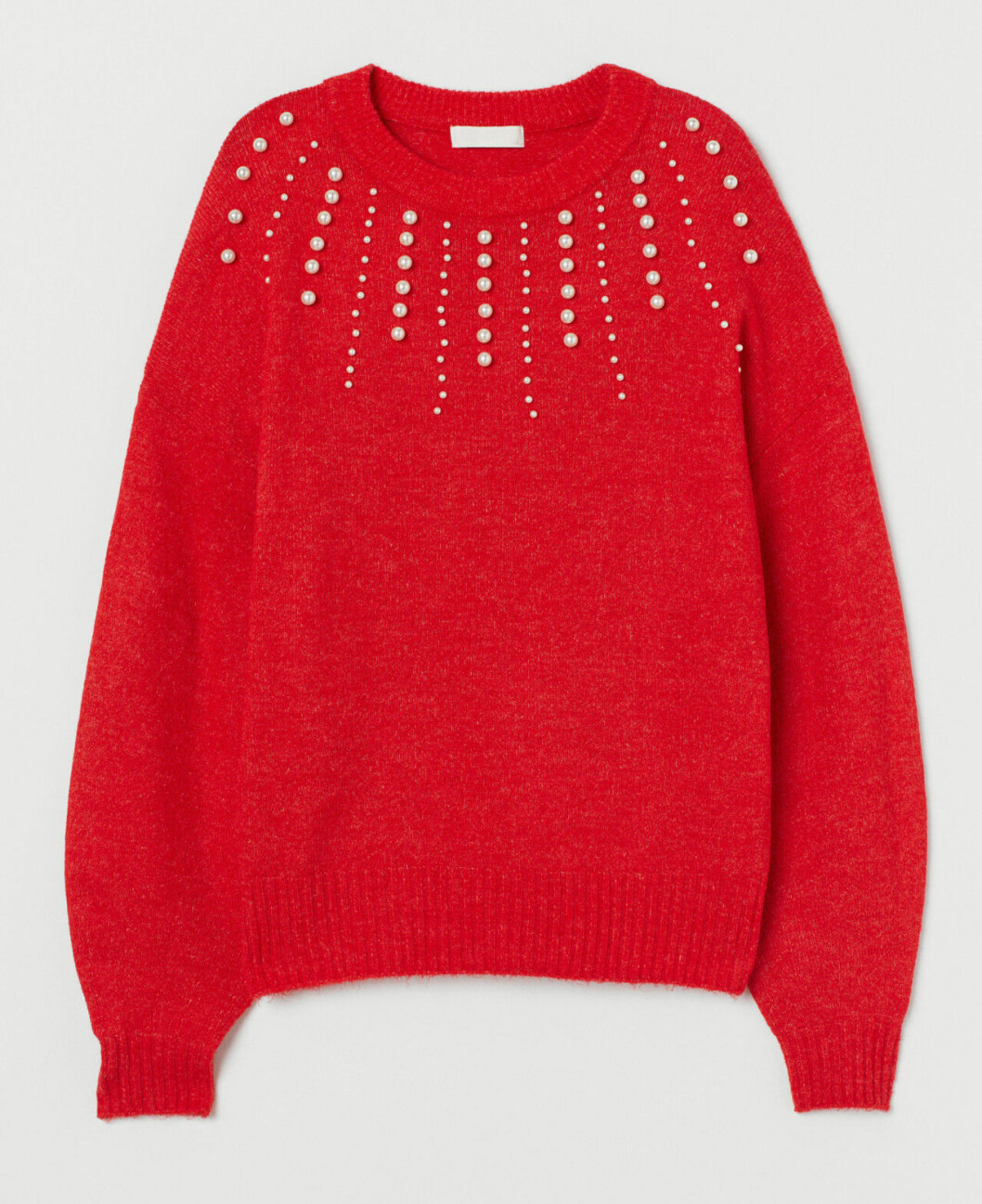 Röd stickad tröja med pärlor till festen