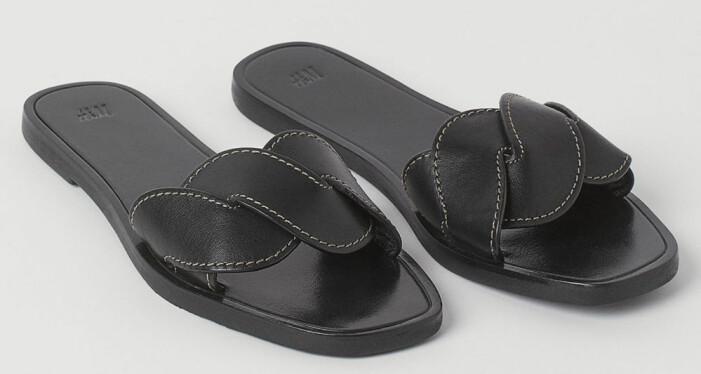 svarta slipin-tofflor i läder