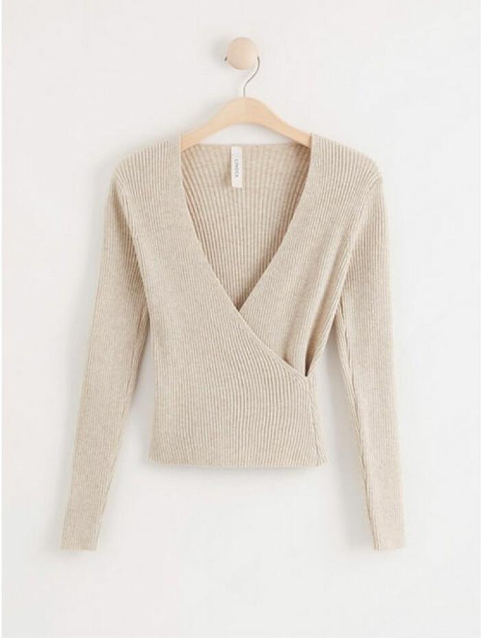 Stickad beige tröja från Lindex
