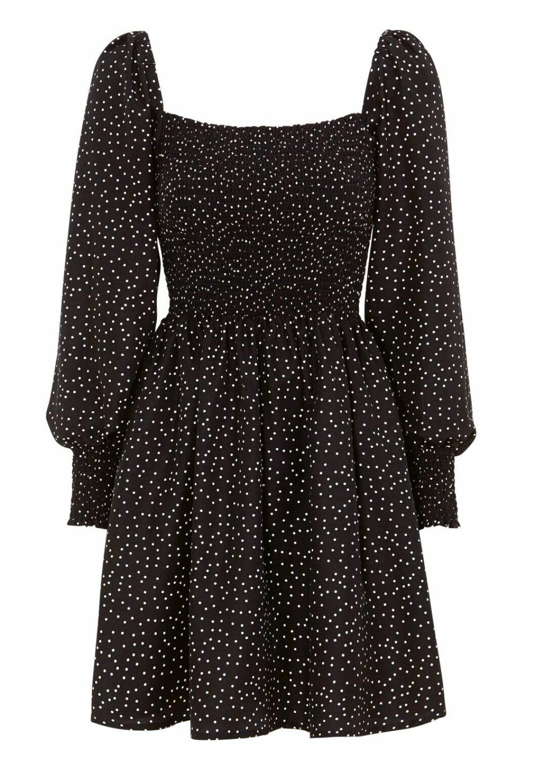 Prickig klänning med smockad detalj för dam till 2020