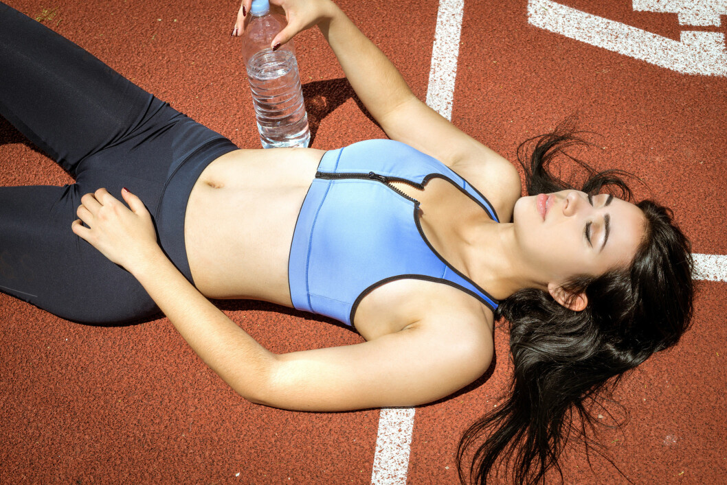 Fitness woman with bottle of water.